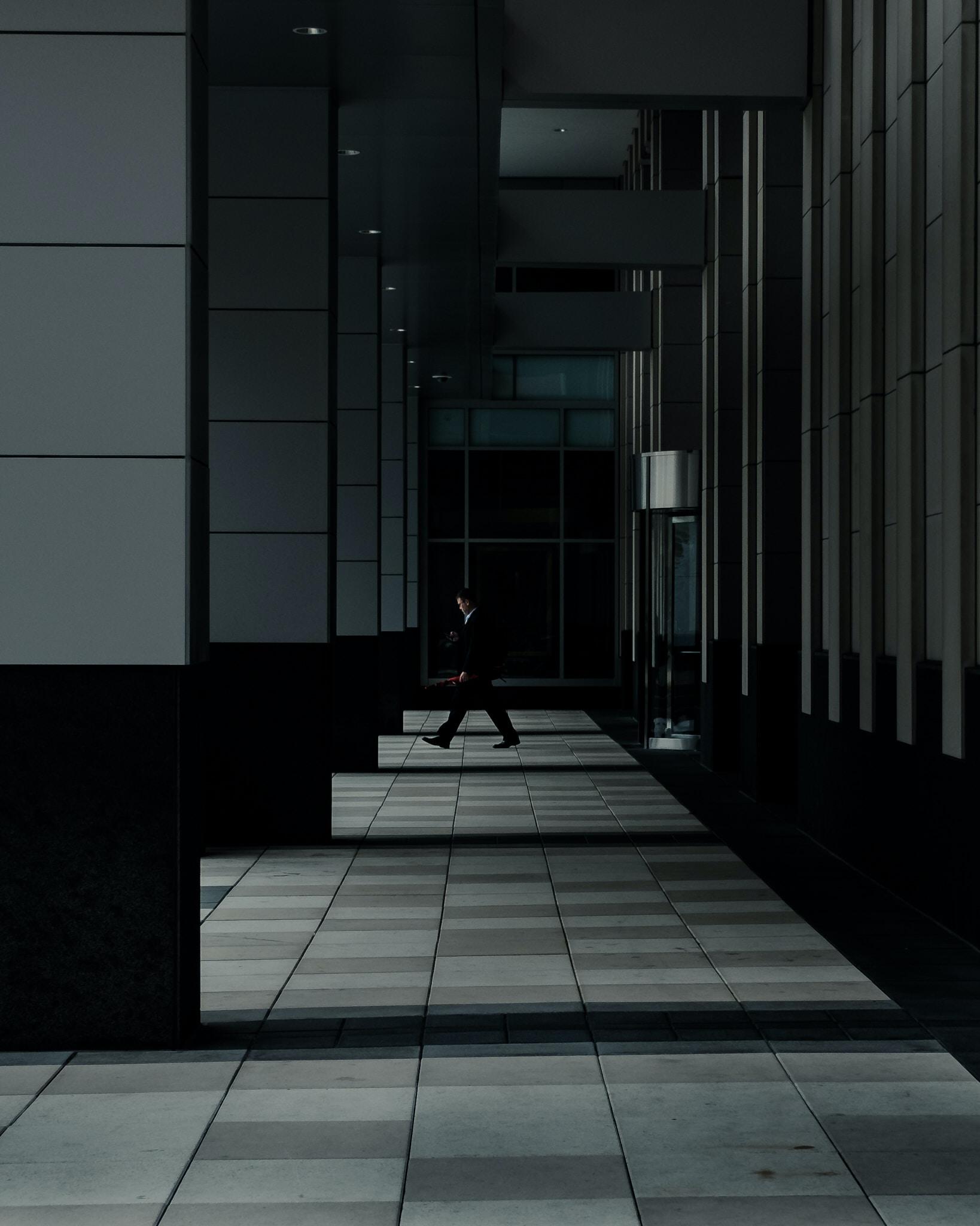 man standing in hallways