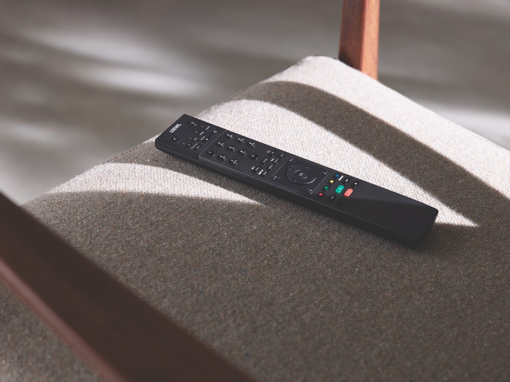 black remote control on chair
