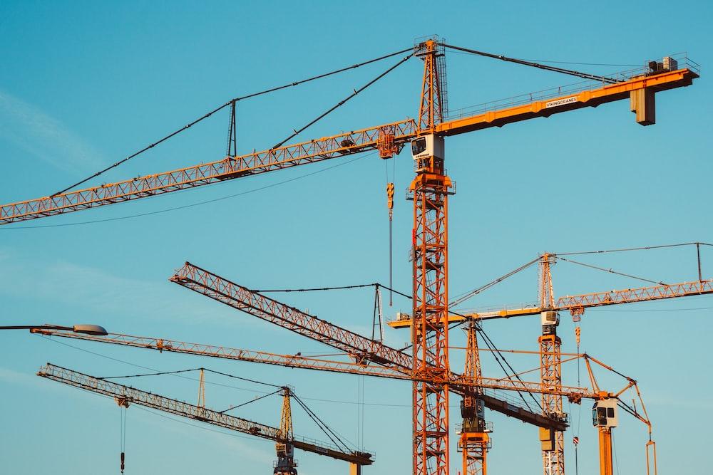 brown tower cranes