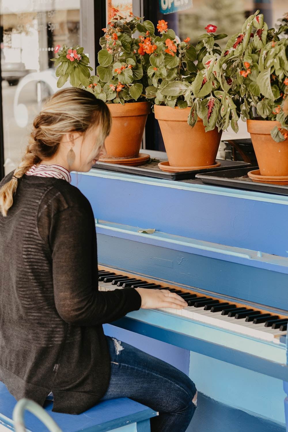 woman playing spinet piano