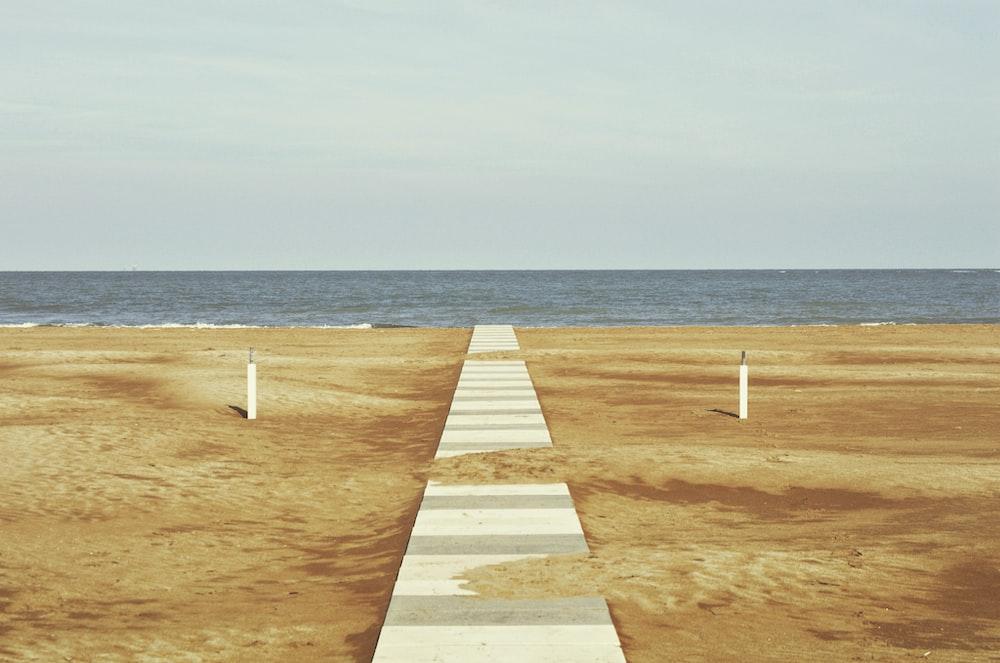 white wooden beach dock