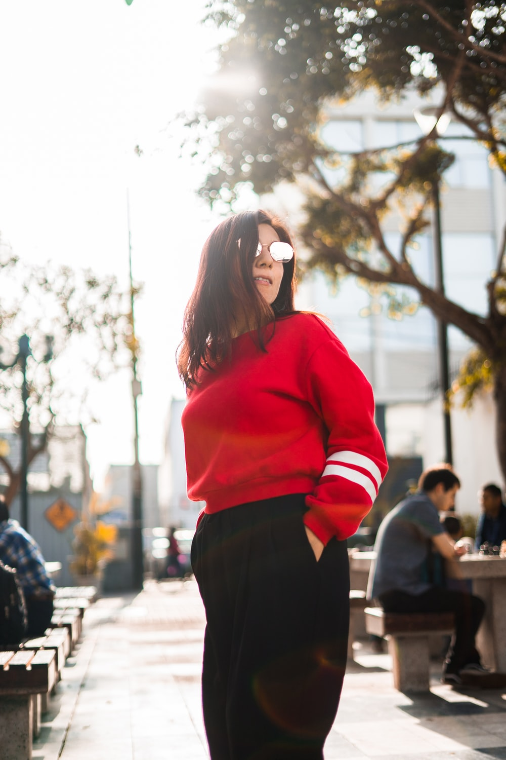 woman in red and white sweater and black bottoms
