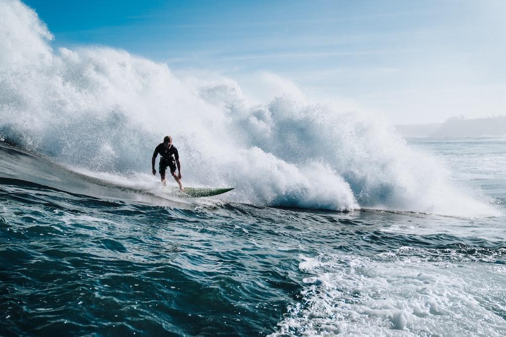 man doing surfing during daytime