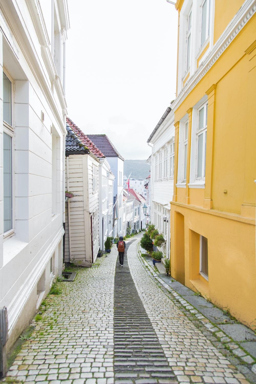 person walking alone at narrow alley