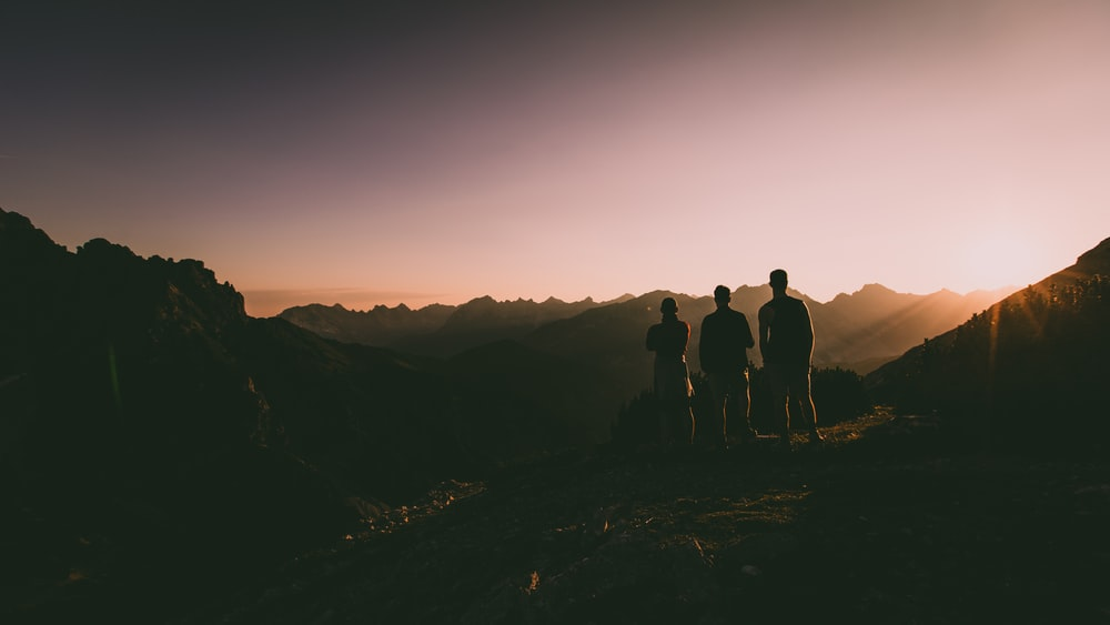 silhouette of three persons