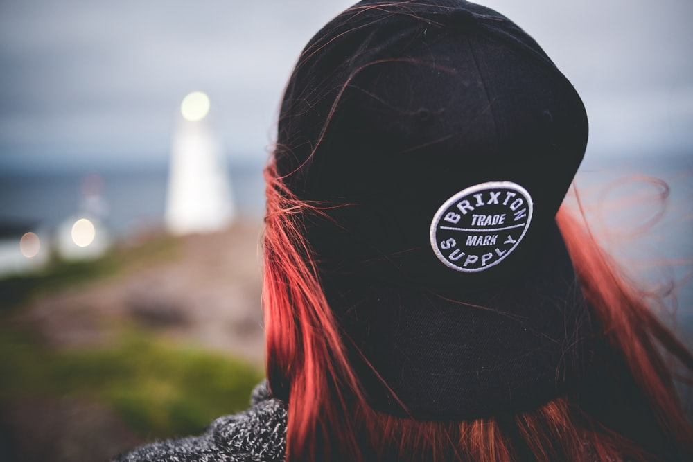 selective focus photography of woman wearing black cap