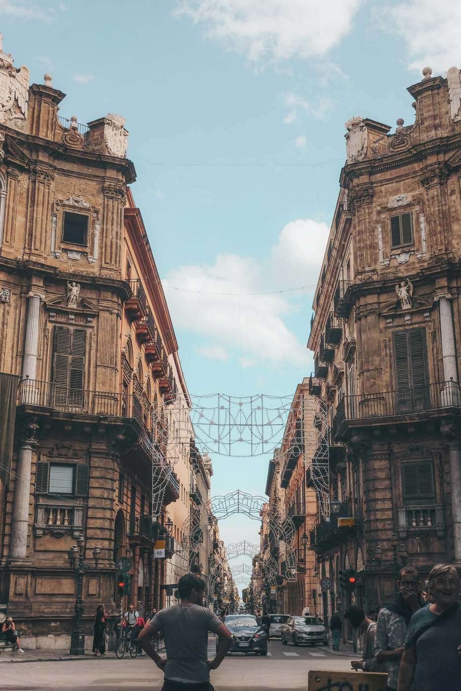 a street lined with buildings in Palermo, Italy