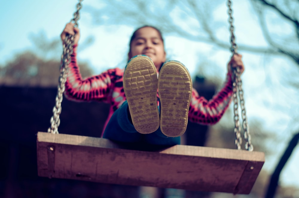 girl riding on the swing