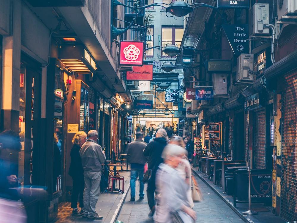 people walking on alley