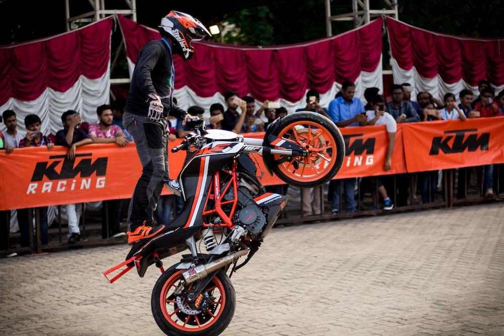 man doing tricks while riding on dirt bike