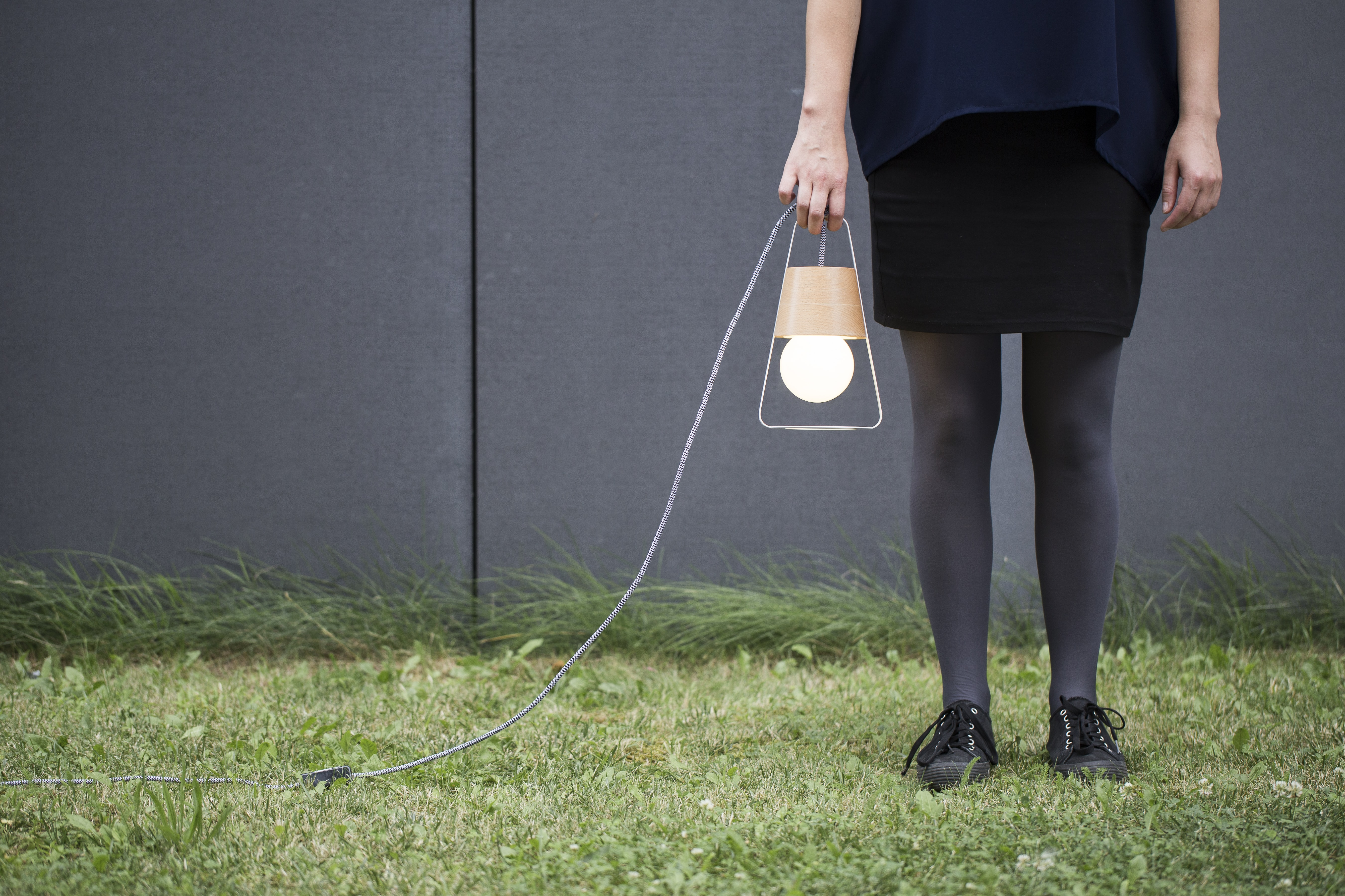 person holding lamp