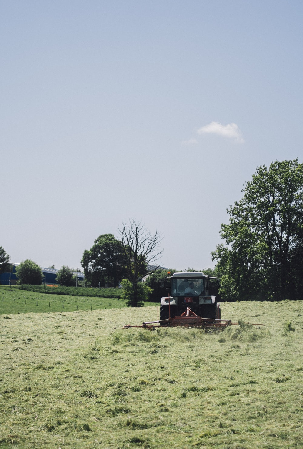 black tractor under blue sky