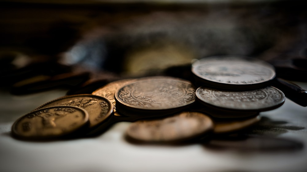 selective focus photography of coins on white surface