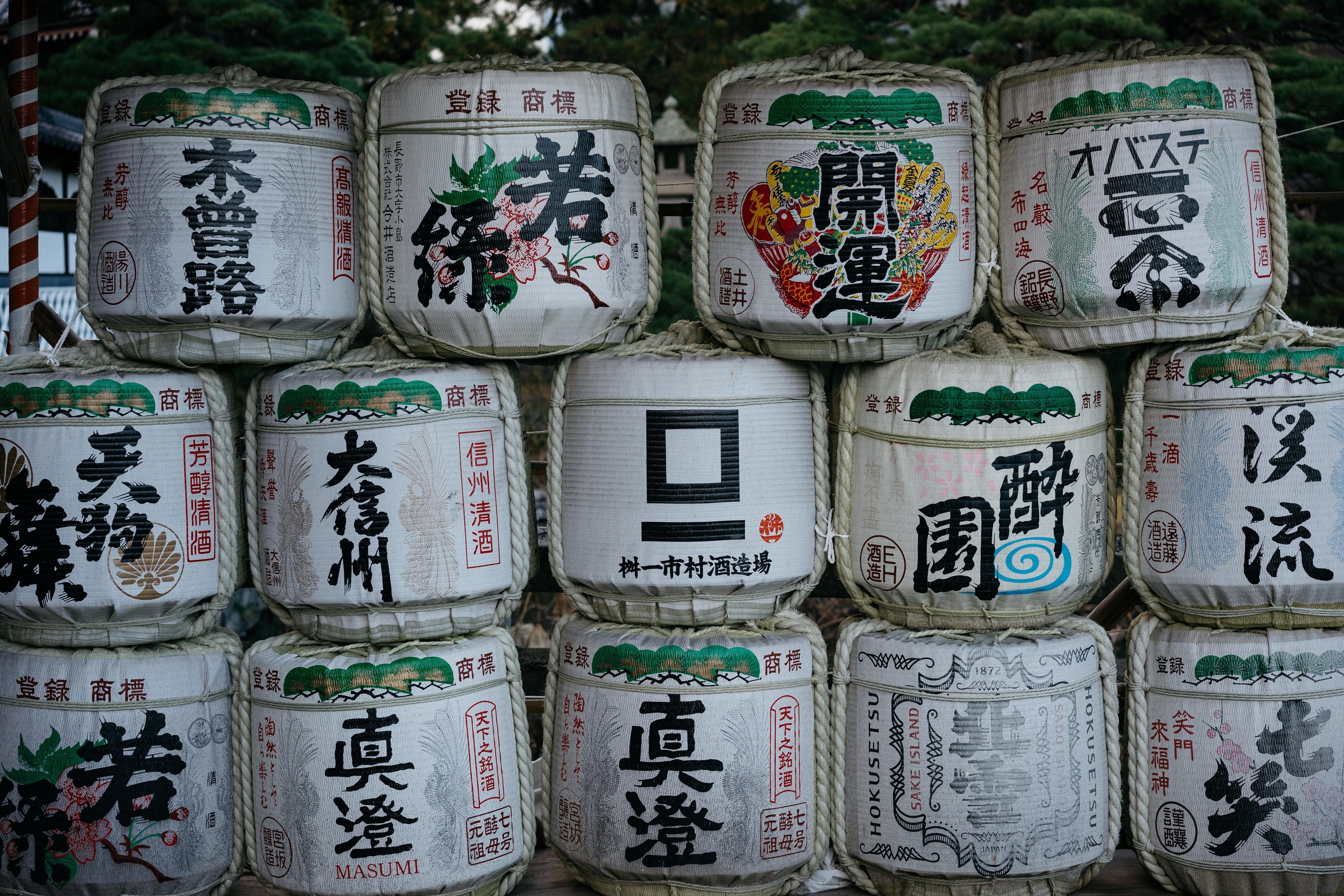 pile of white-and-green containers