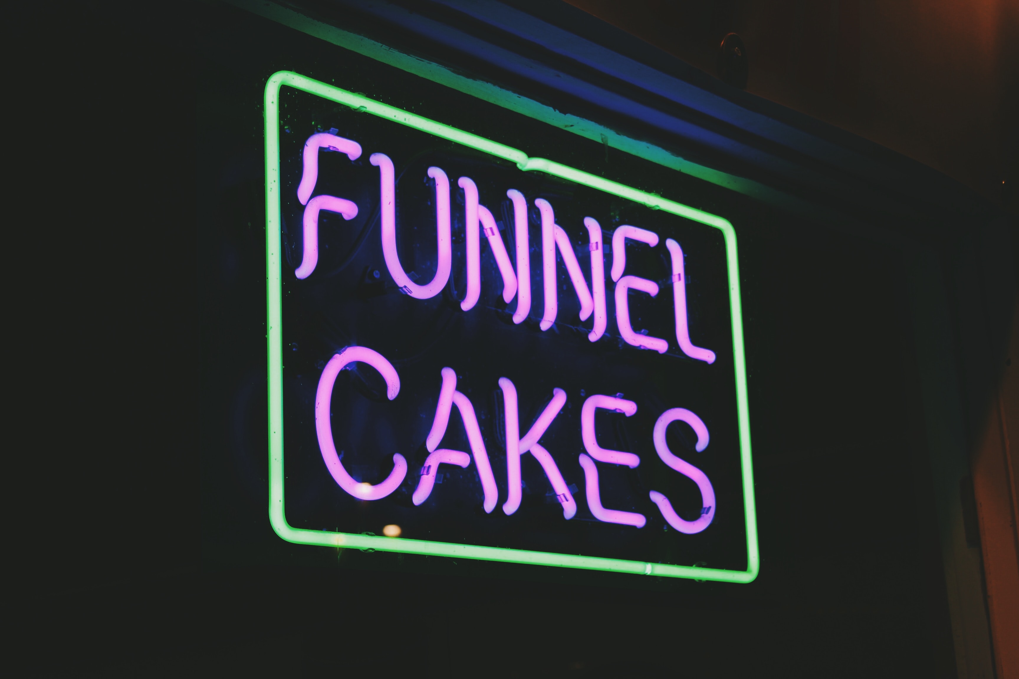 purple funnel cakes signage
