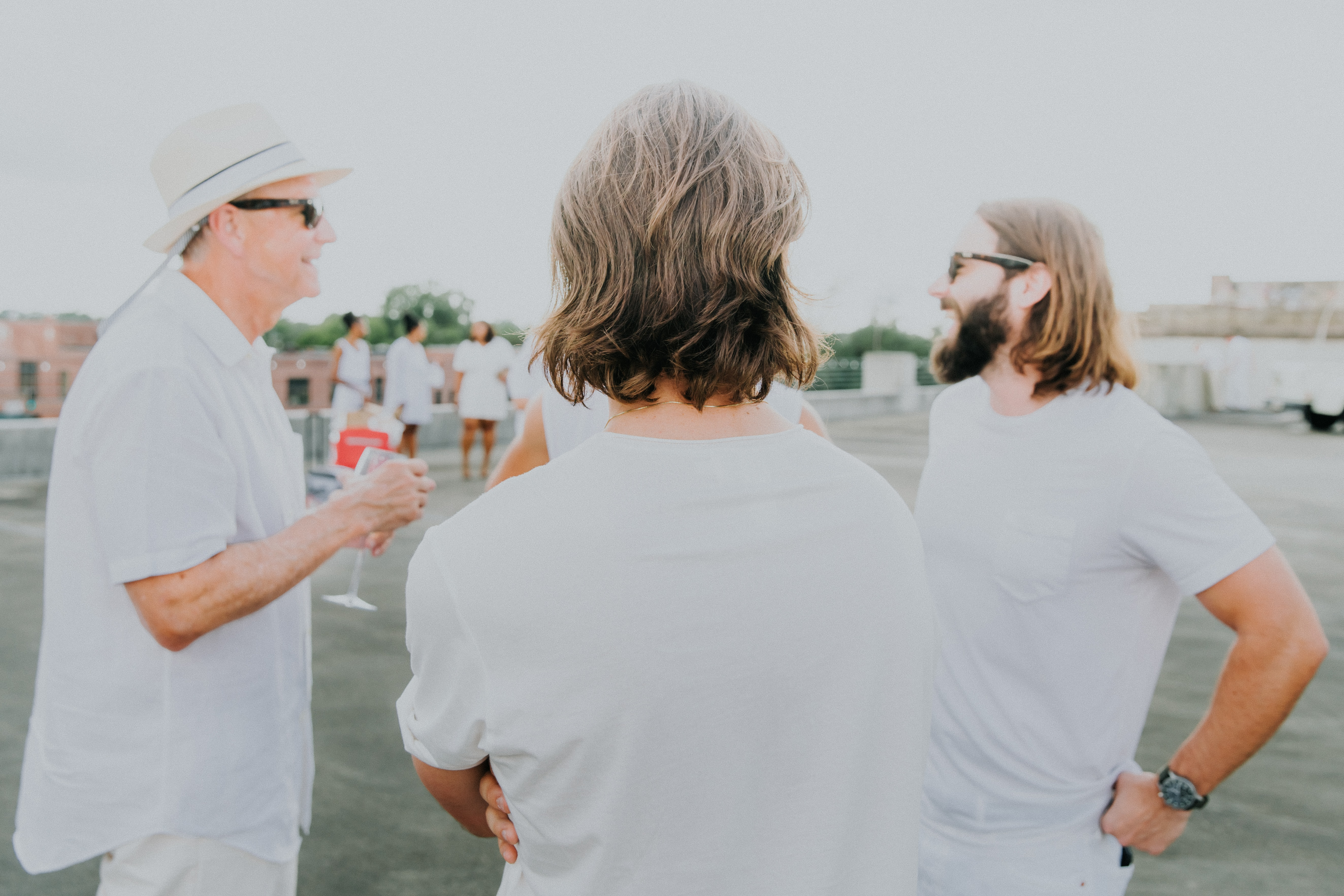 men wearing white shirt standing during daytime