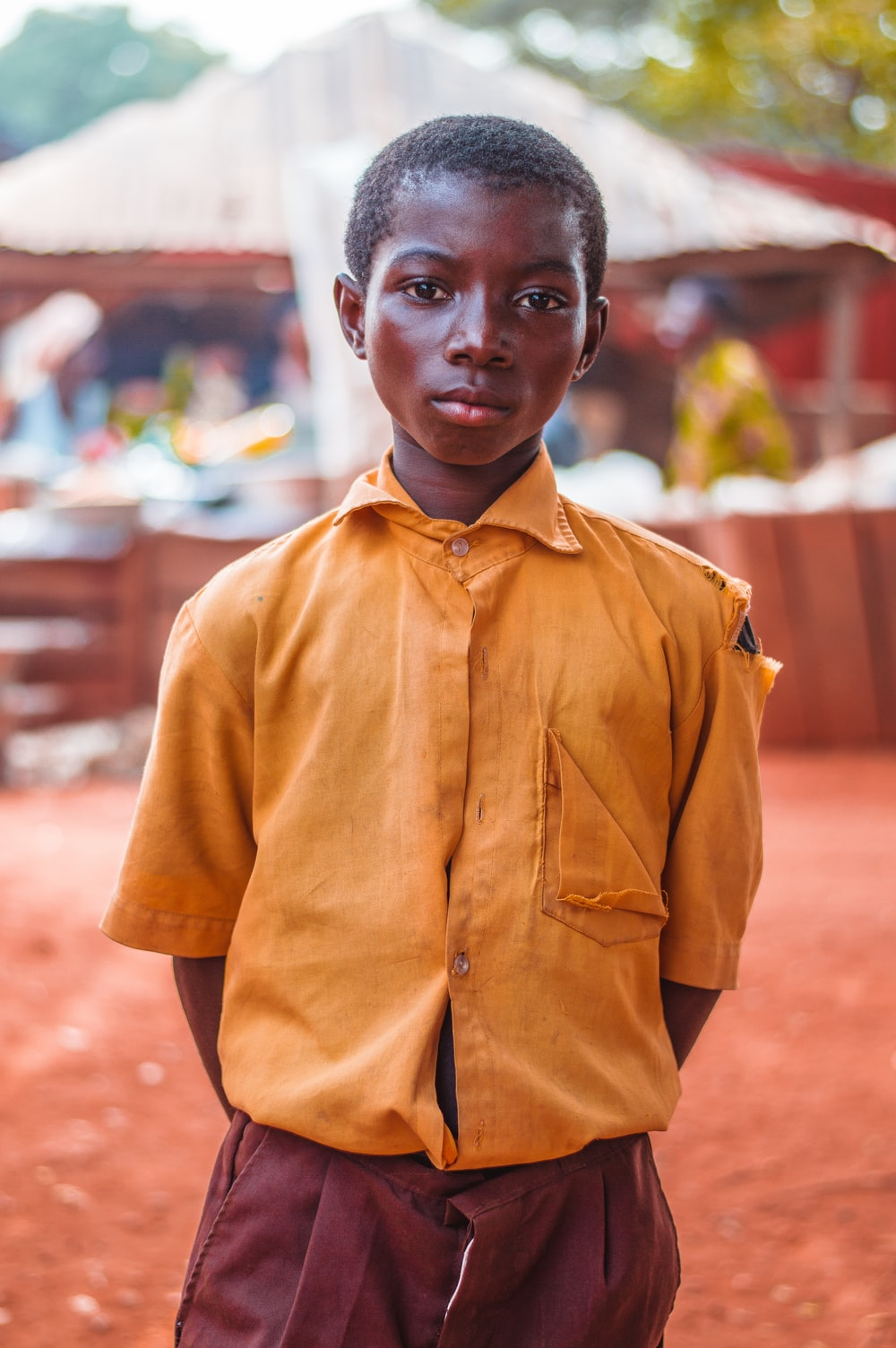 selective focus photo of boy standing