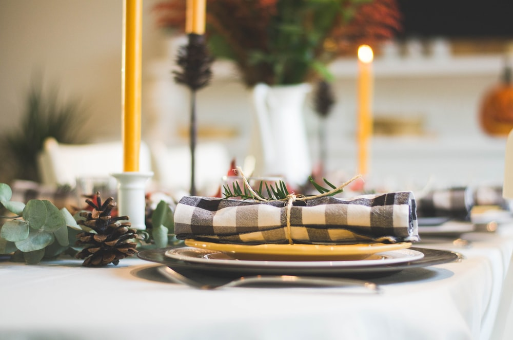 handkerchief on plate near candles on table