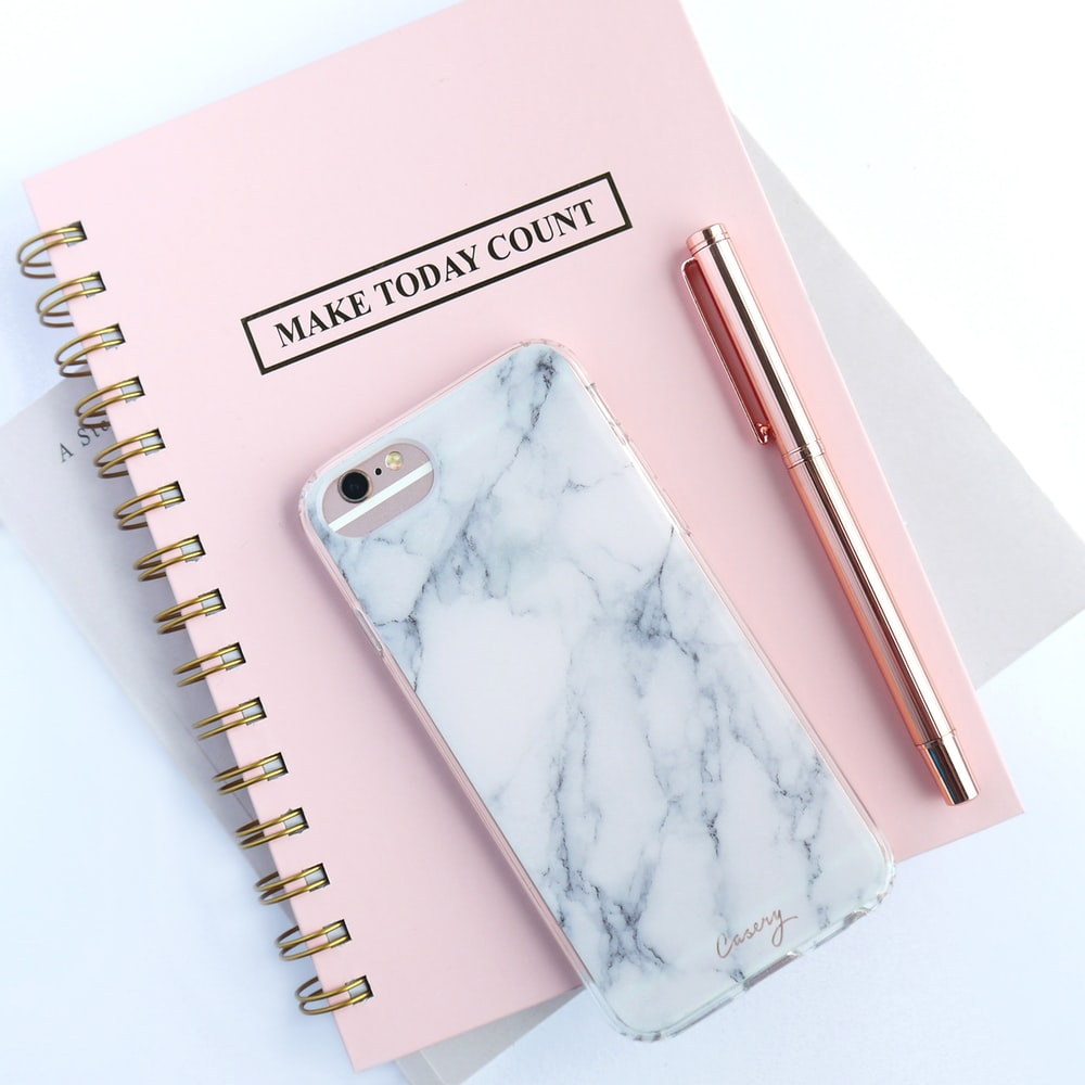 rose gold iPhone 6s and white and gray marble case