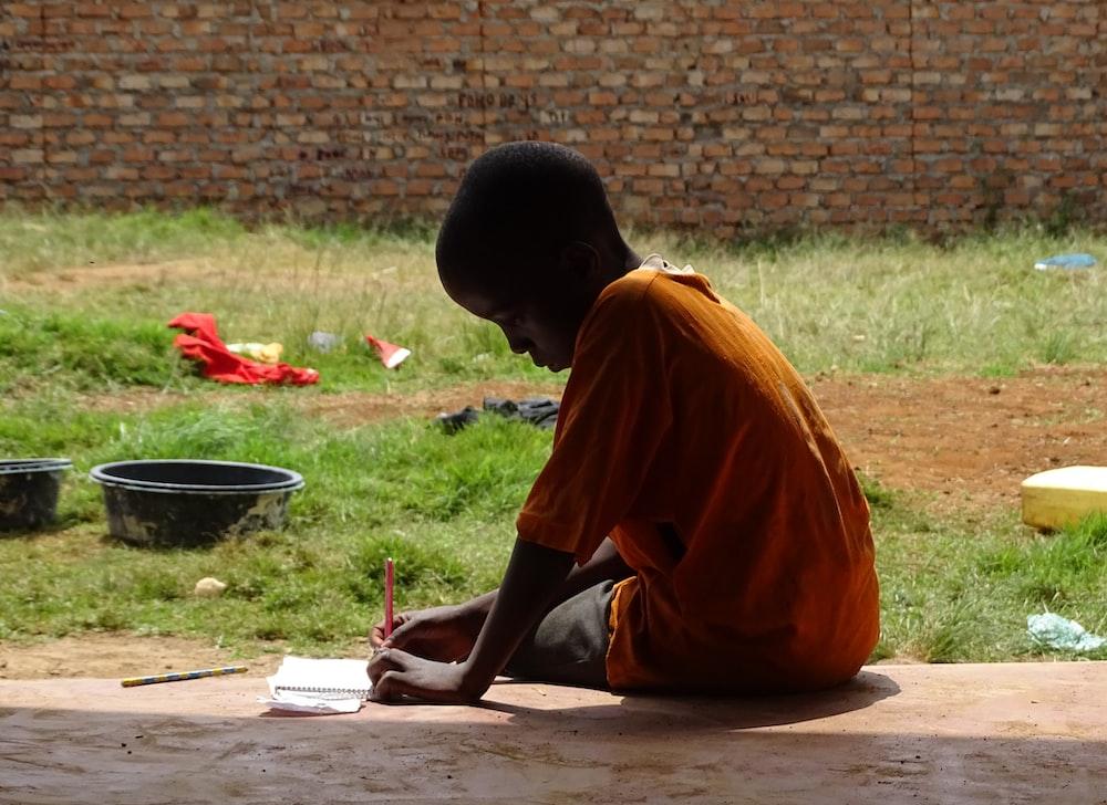 boy writing on notepad