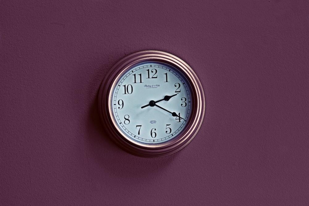 round brown analog wall clock