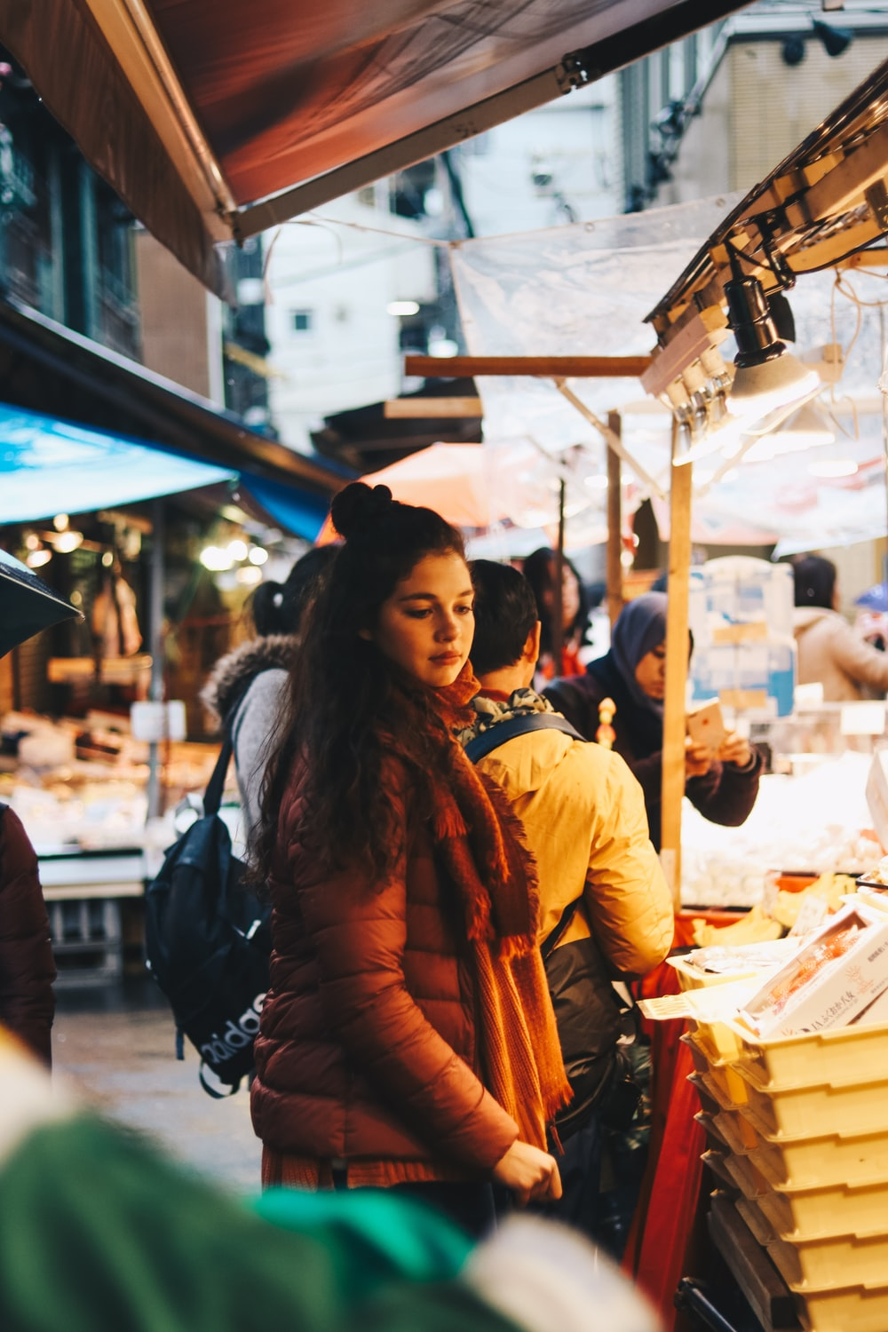 woman standing in front of stall