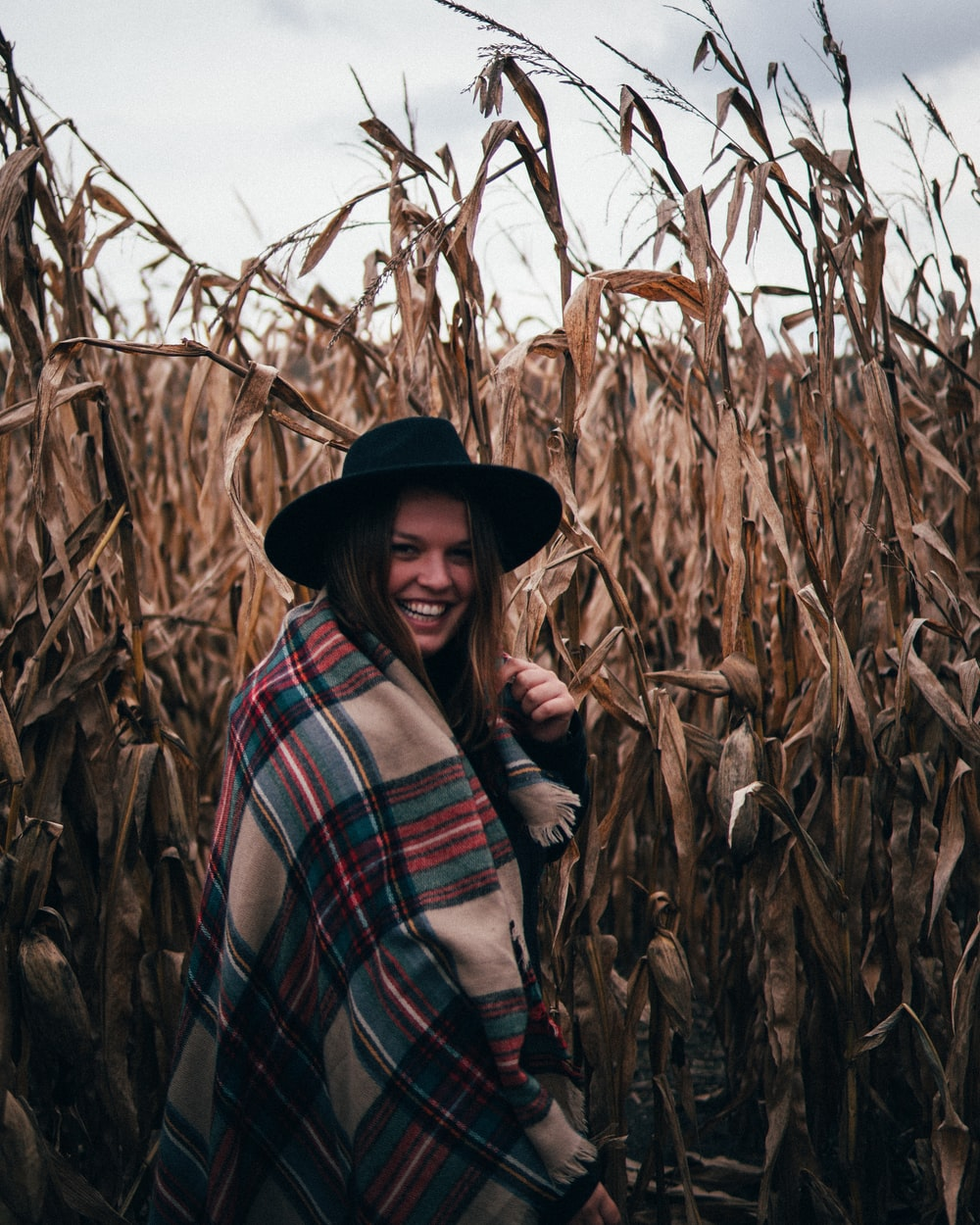 woman smiling in the middle of a wheat field