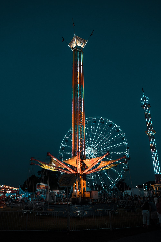 lighted Ferris wheel during nighttime