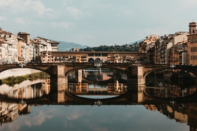 bridge over body of water during daytime florence zoom background
