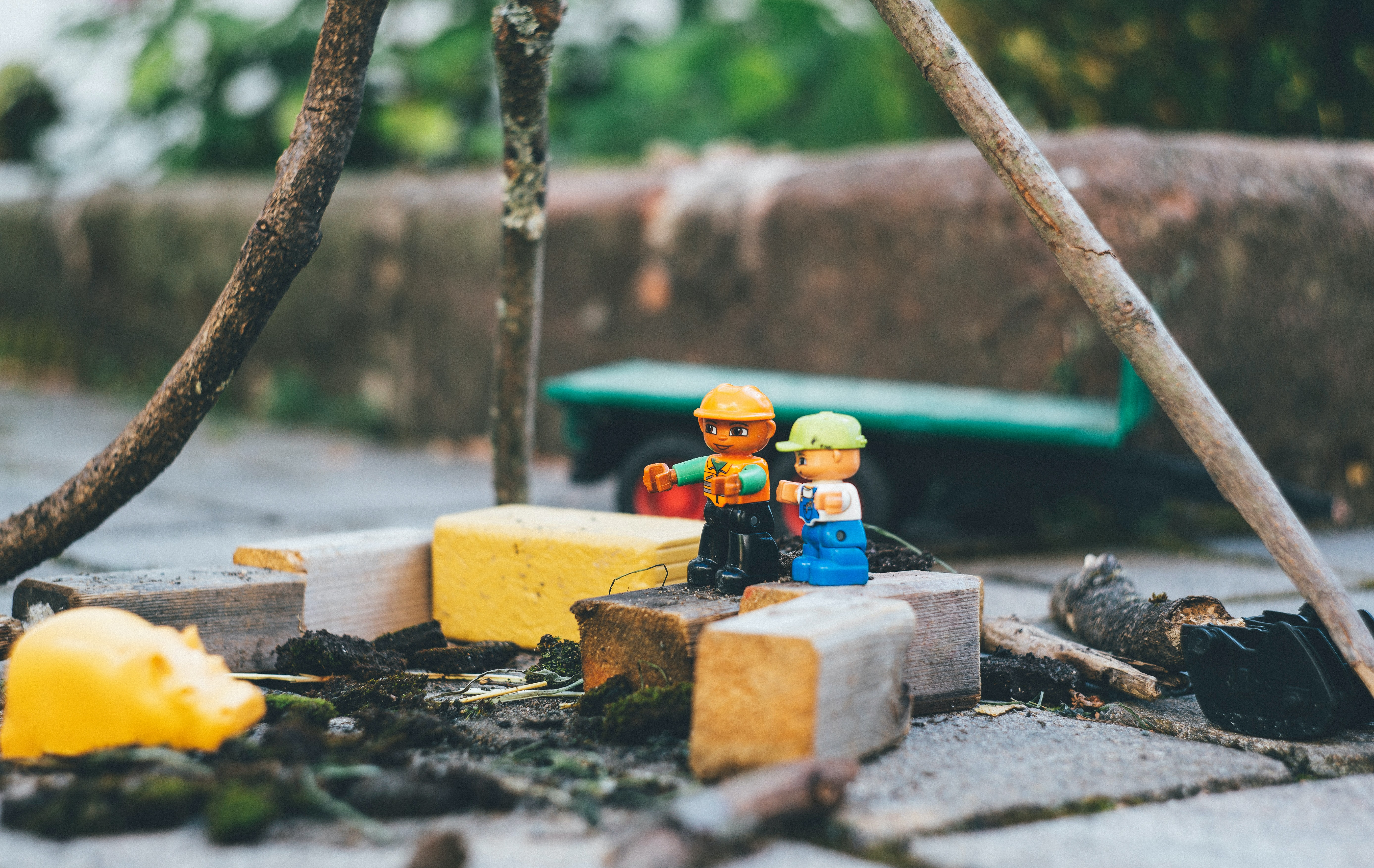 two lego toys on wooden bricks close-up photography