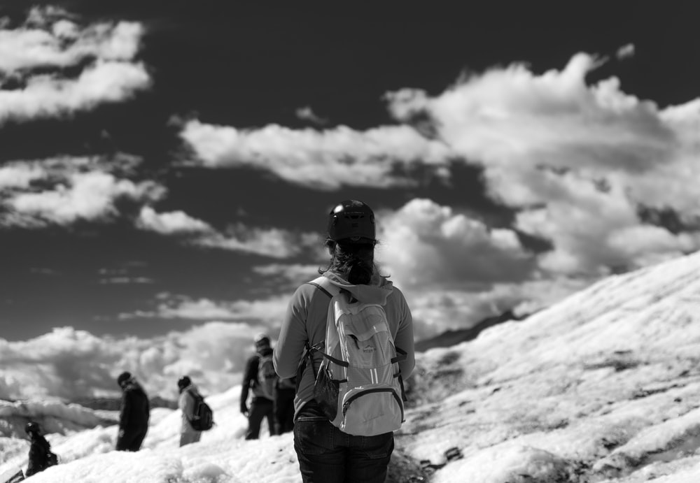 people on mountain during winter