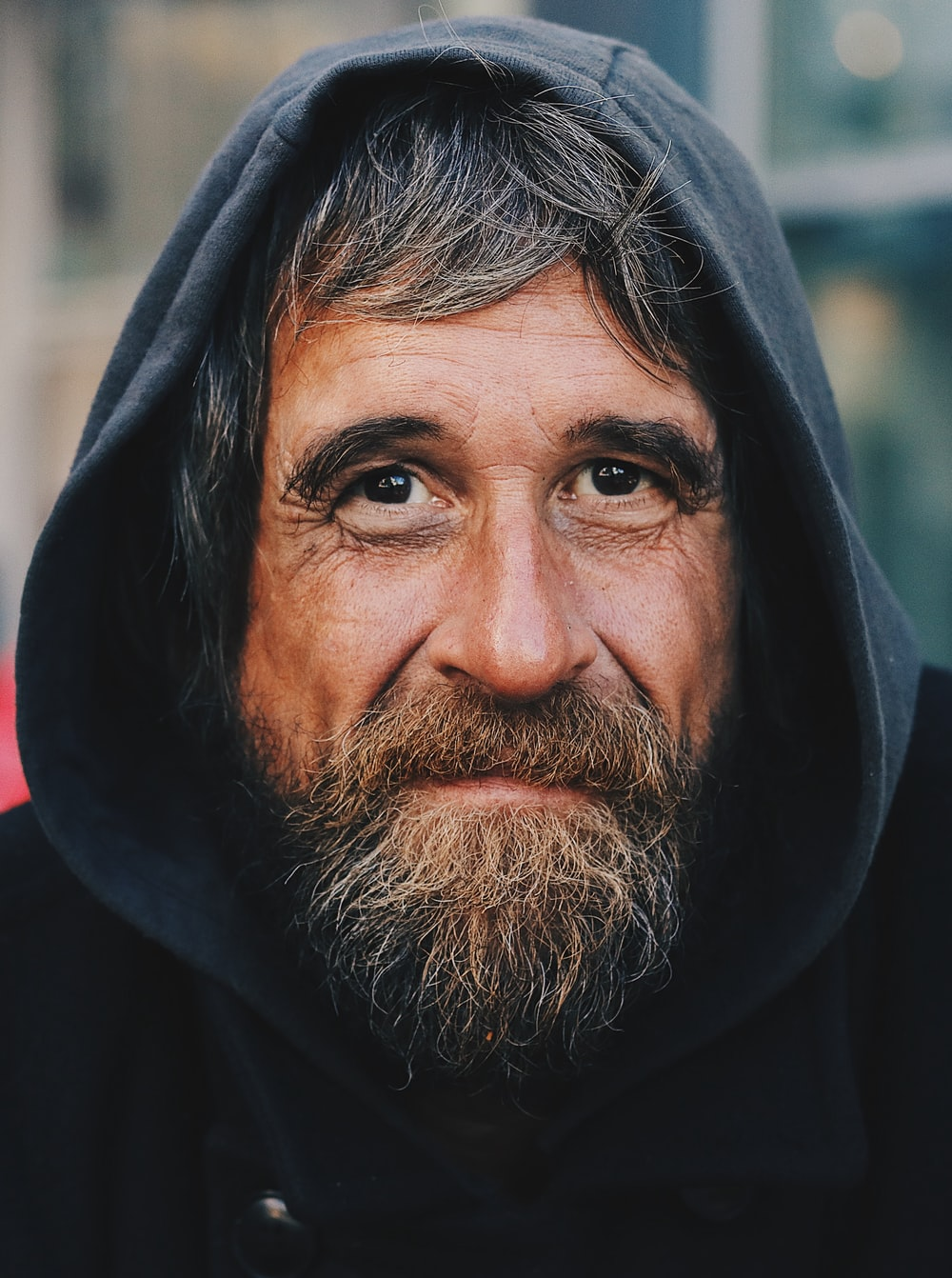 portrait photo of a man wearing hoodie