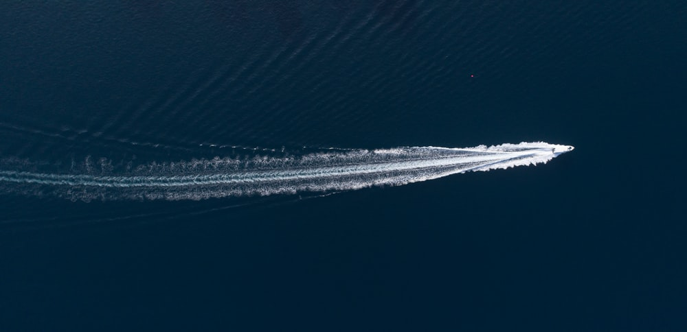 white speedboat made a track on water