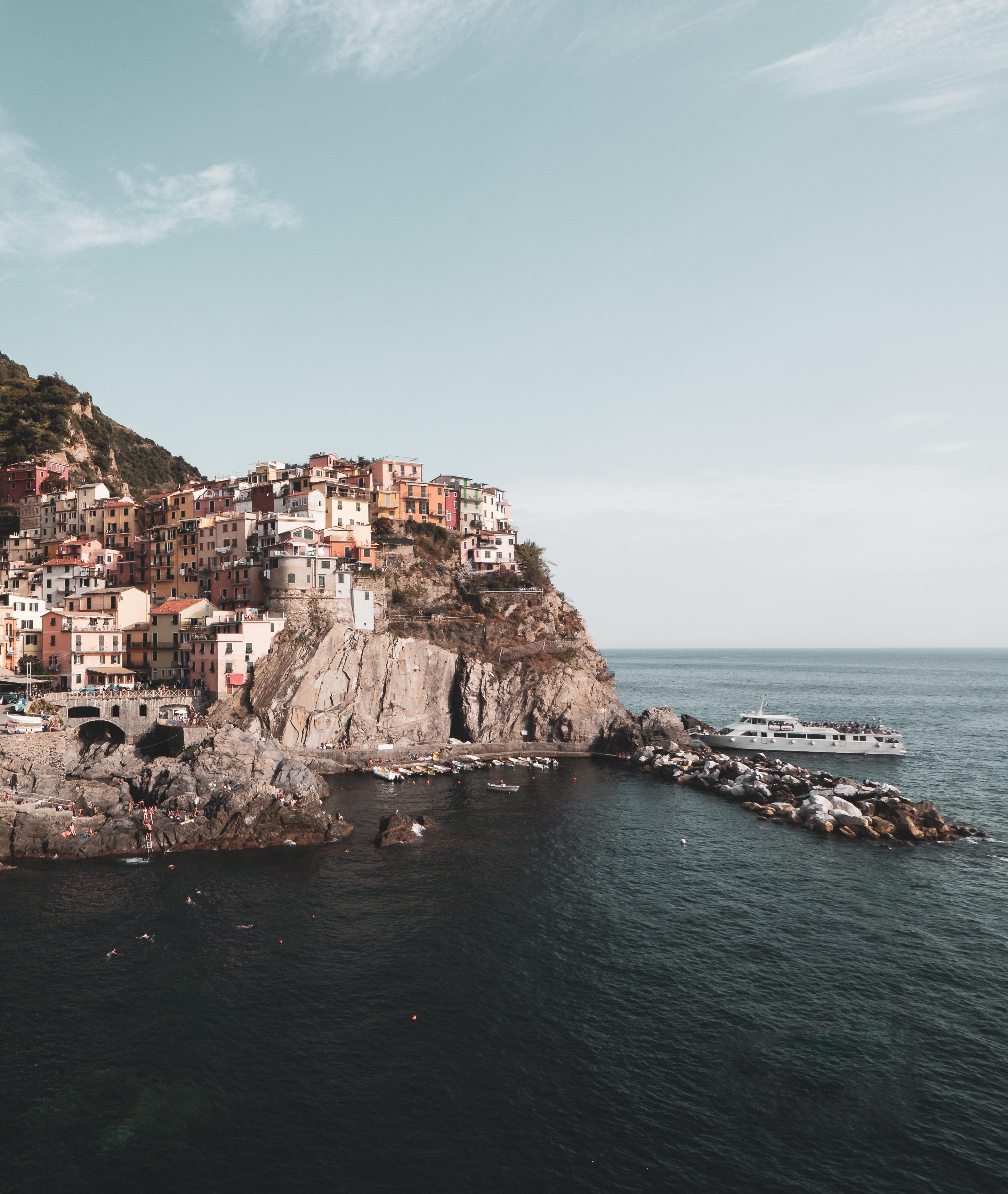 ship docked beside cliff