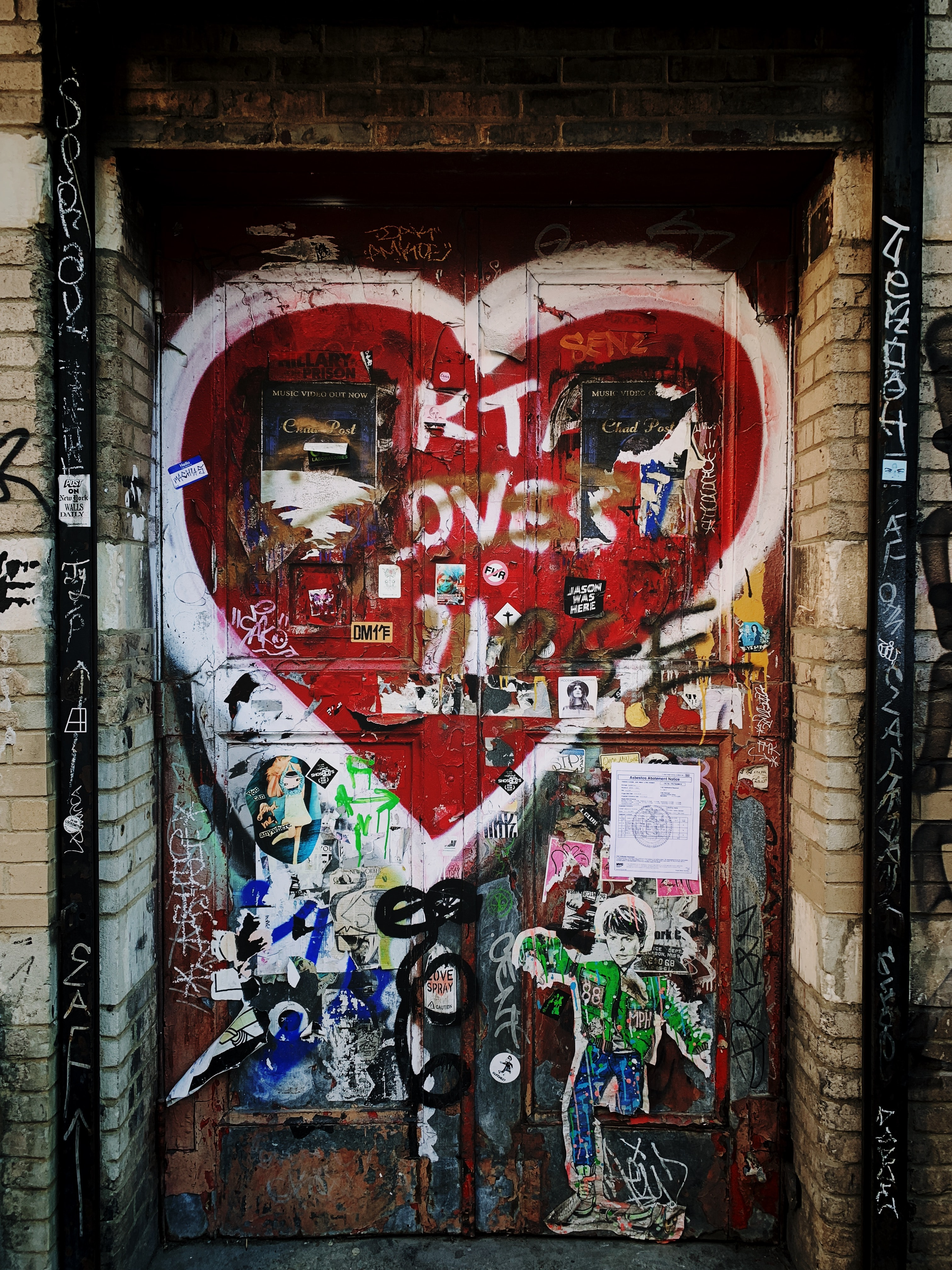red door with white heart paint