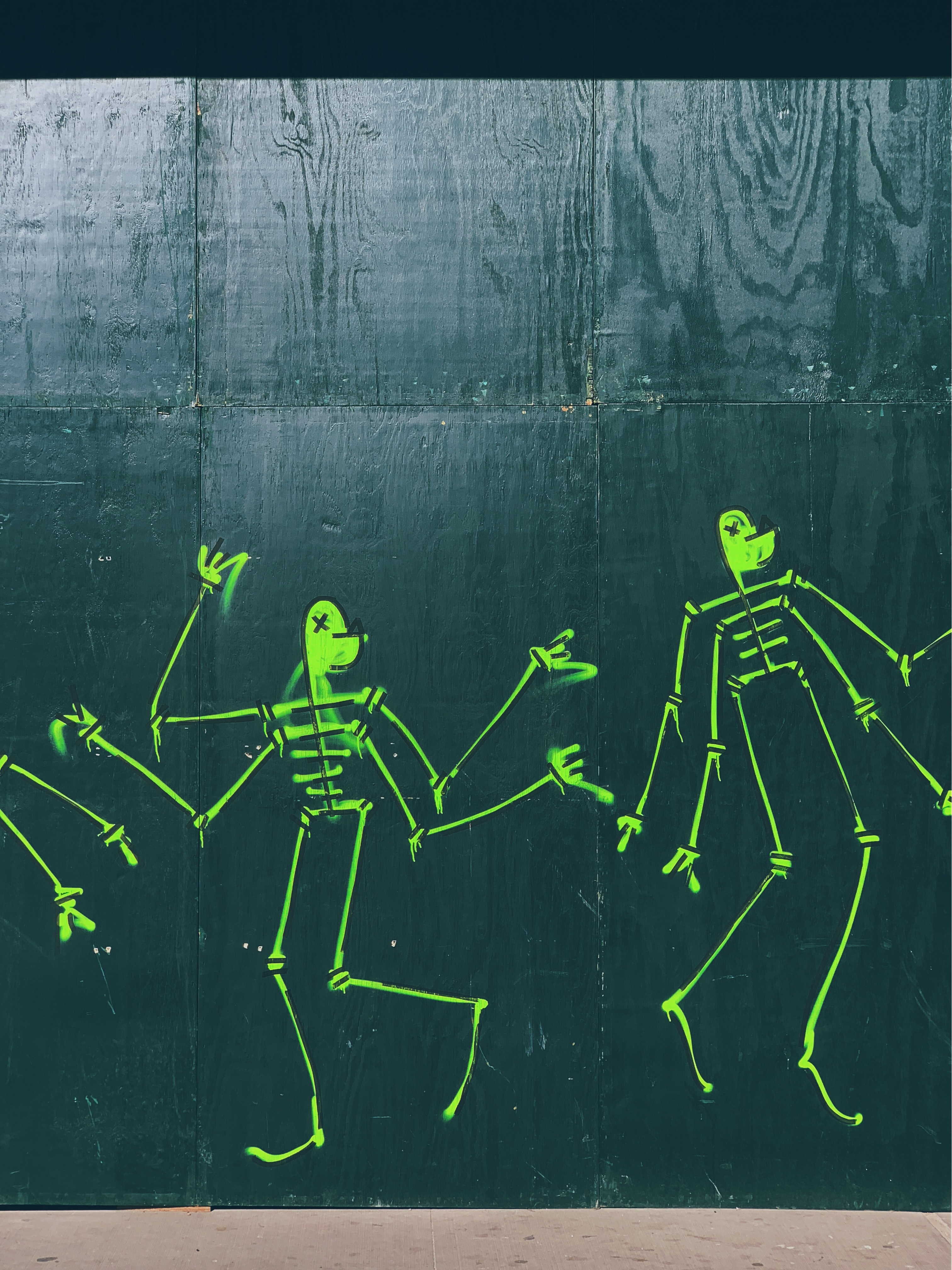 green skeletons painted on wall