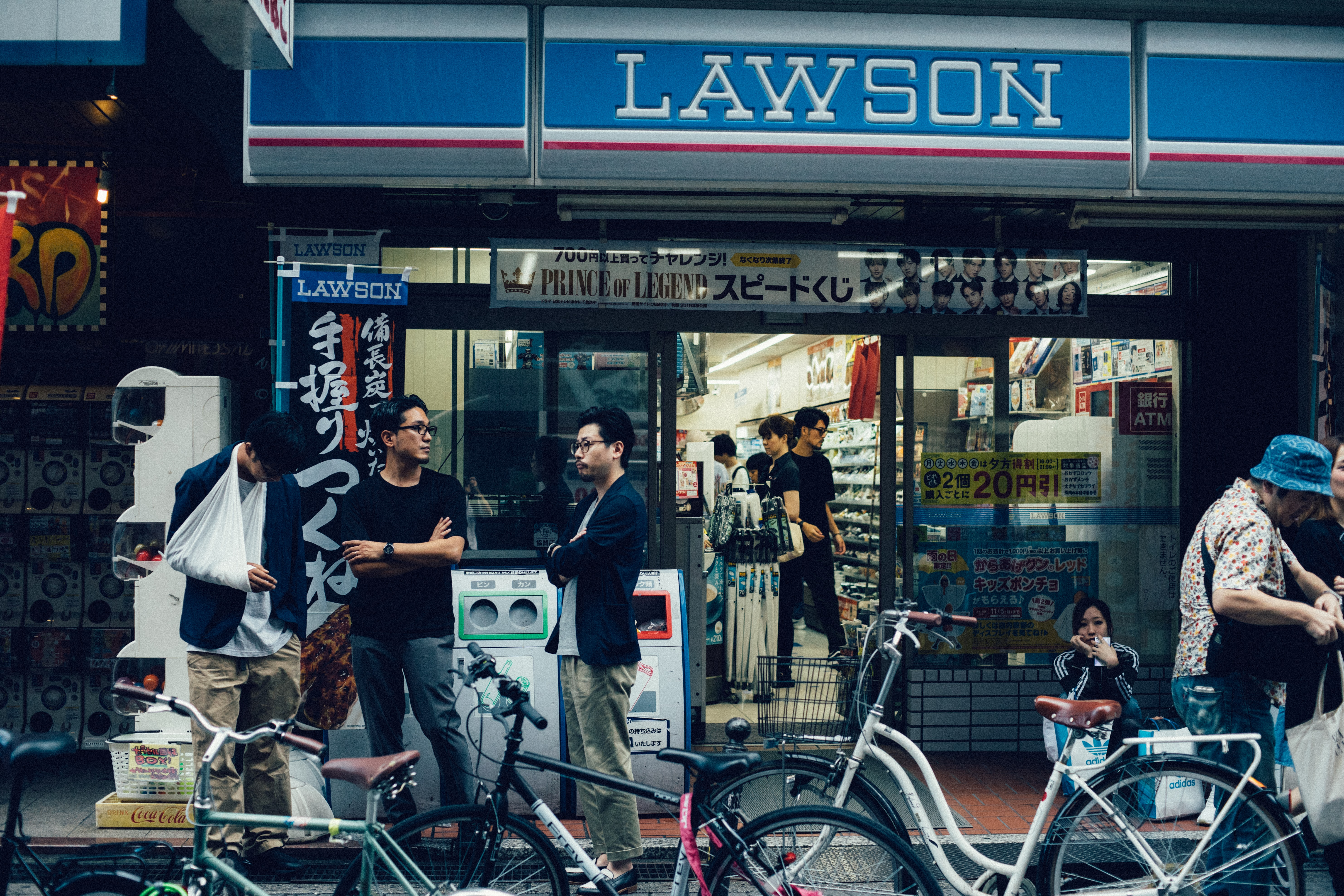 people standing near Lawson stall
