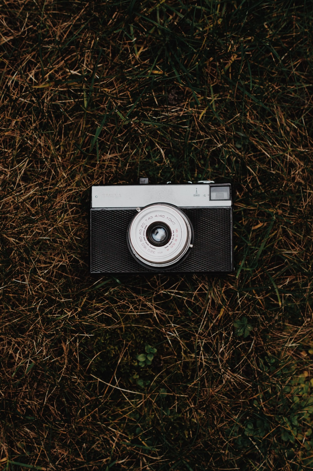 black and gray camera on grass