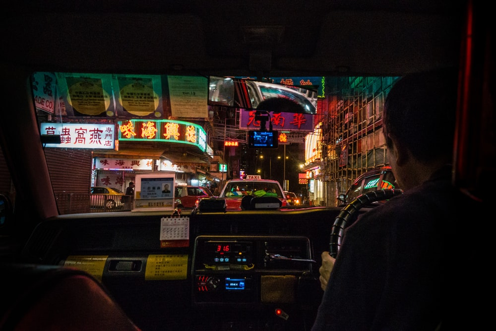 person driving vehicle at night-time