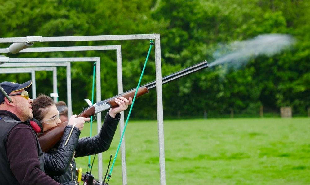 woman firing rifle