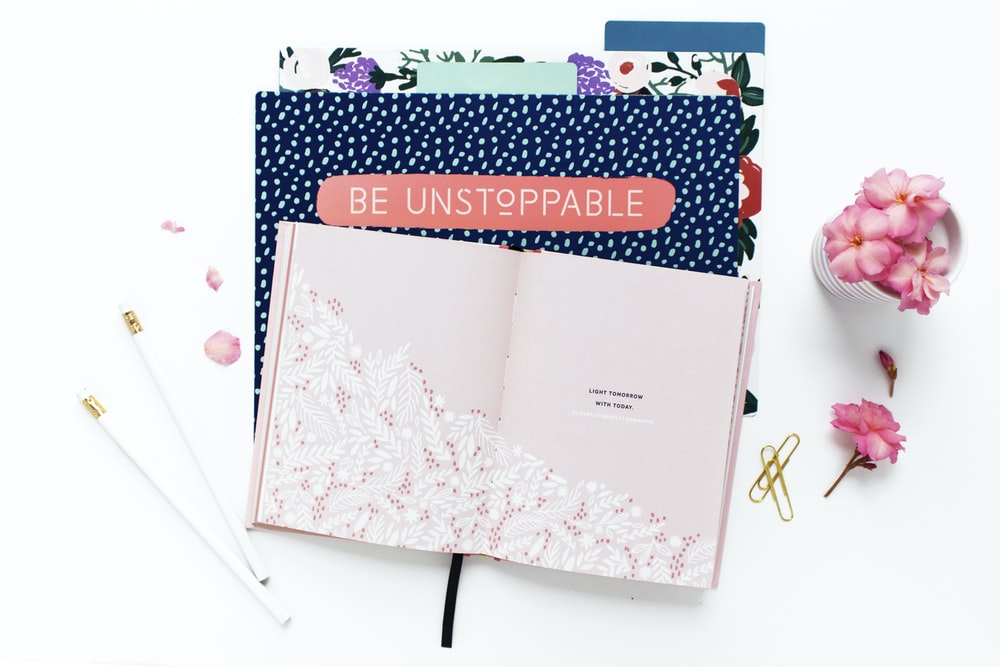 pink and white floral book