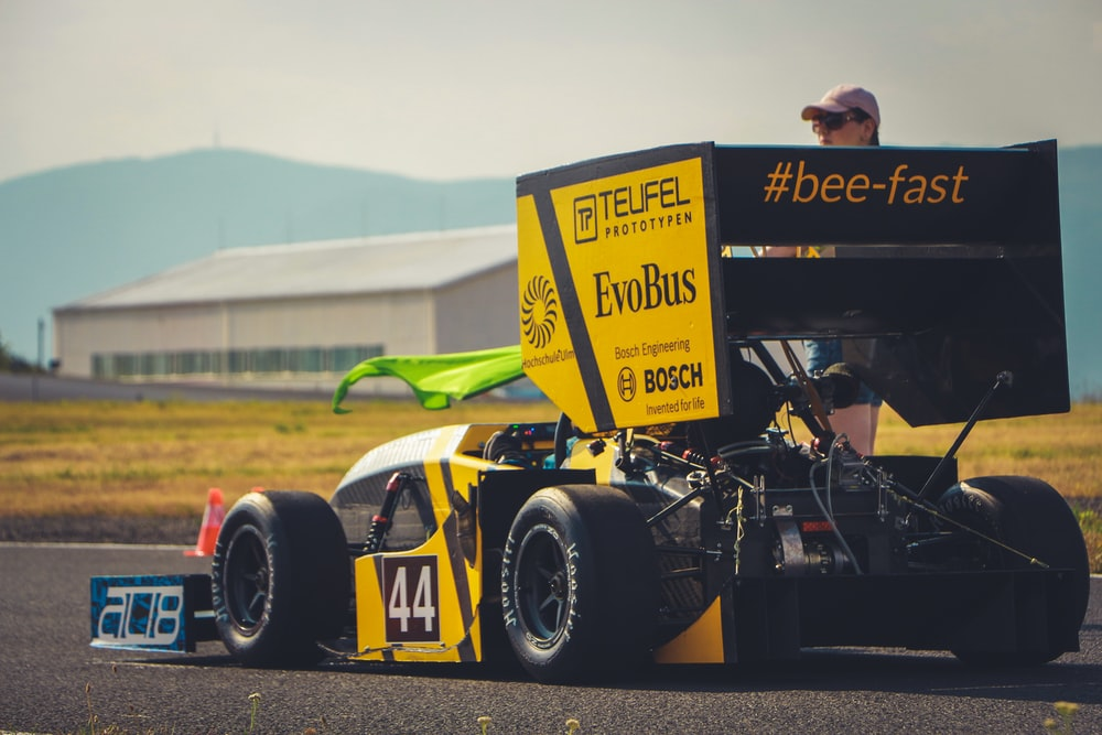 yellow and black F1 car