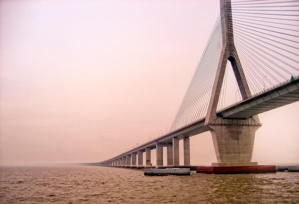boats under bridge
