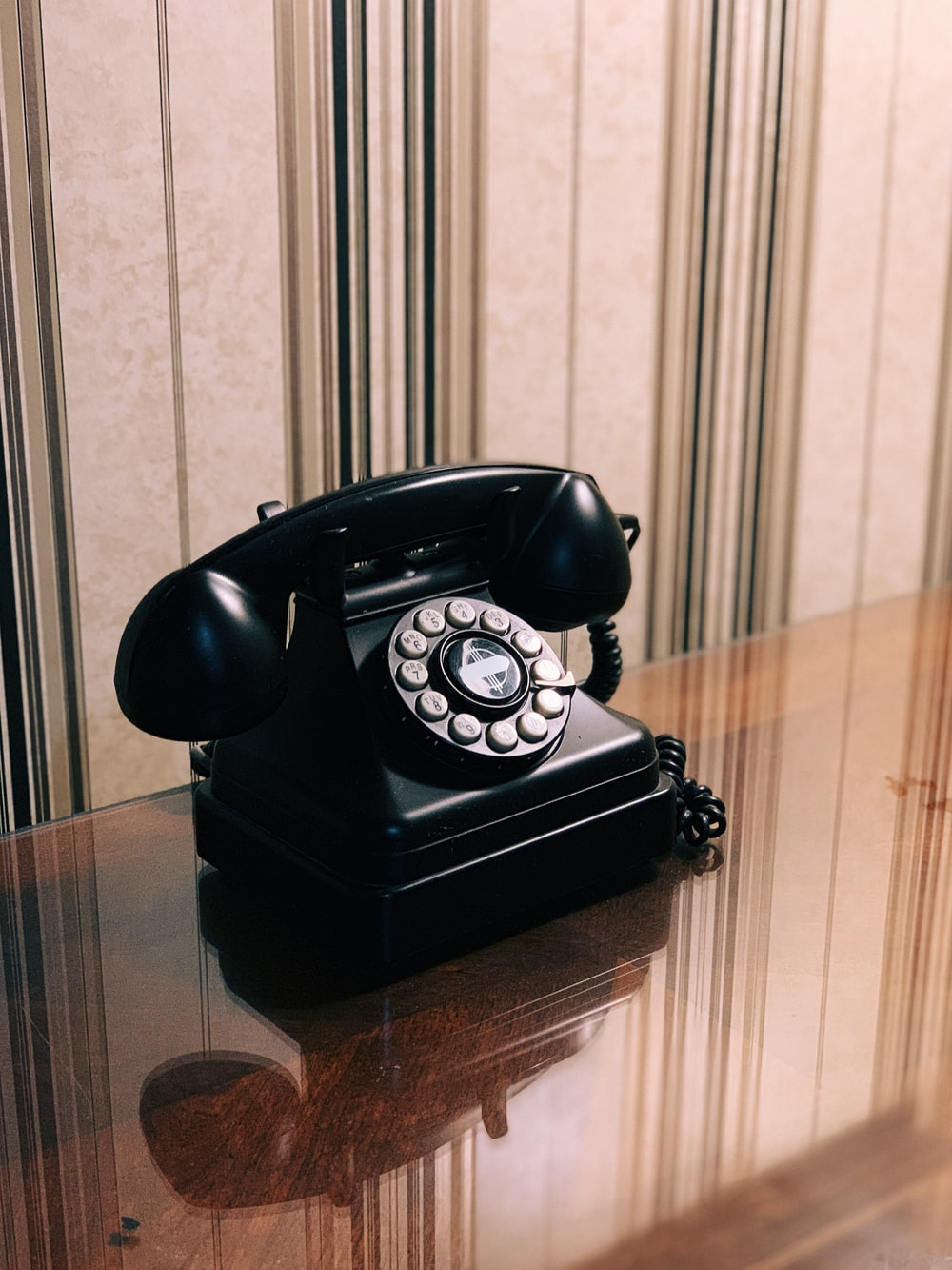 selective focus photography of telephone