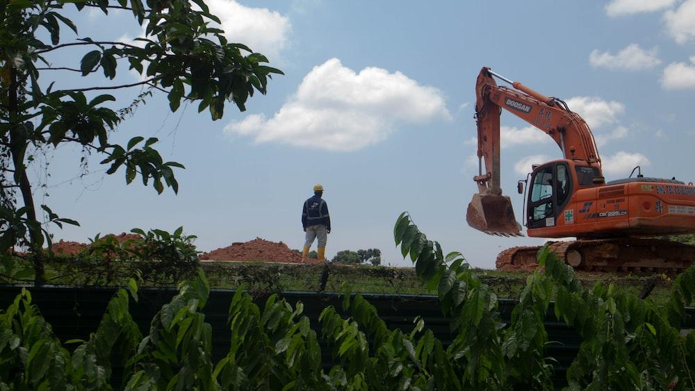 person standing near excavator