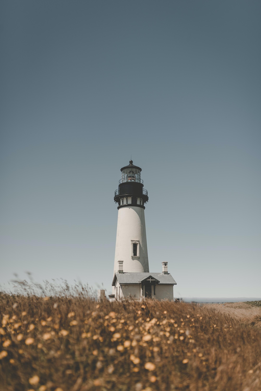 lighthouse under blue sky
