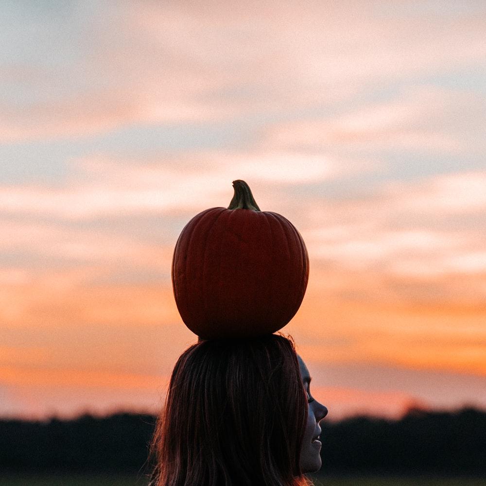 pumpkin on woman head