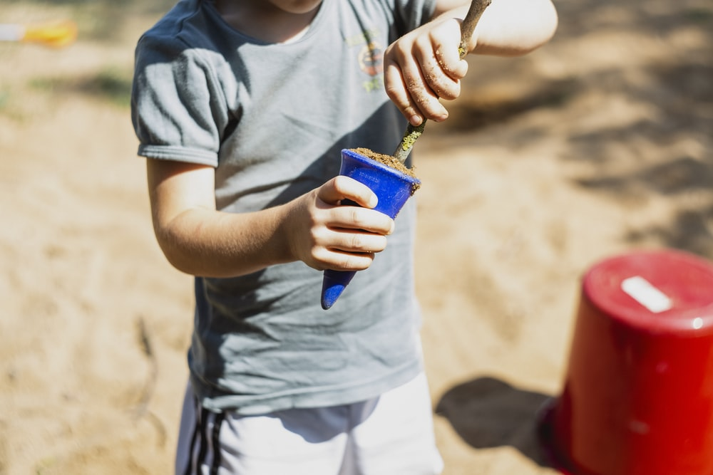 boy in gray shirt playing cone