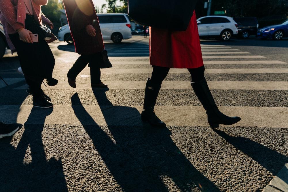 people walking along pedestrian lane