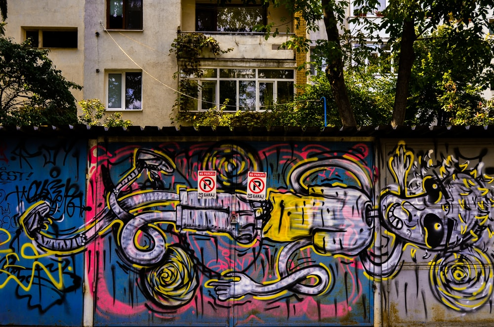 pink, teal, and yellow street art